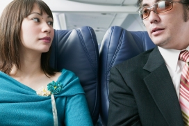 Adult couple traveling in an airplane